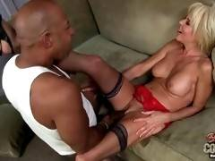 Slutty blonde is doing amazing blowjob on the sofa